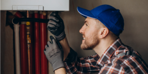 Service man adjusting house heating system Freepik